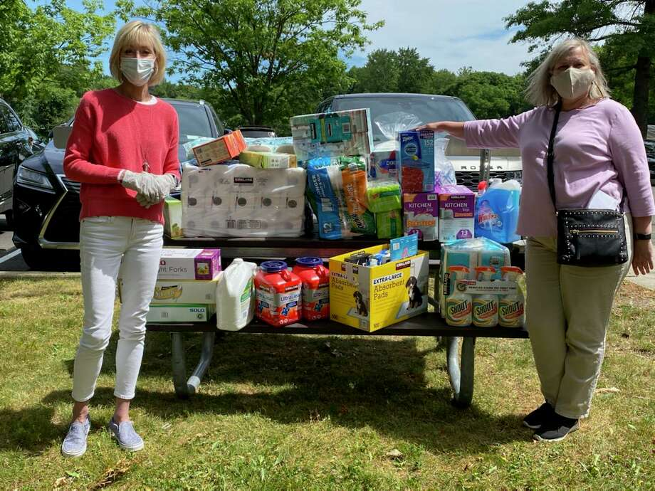 Laurie Griffith, branch manager, assistant vice-president of Darien Bank & Trust, right, donated $500 worth of household items to Diane Barston, program assistant, Darien Human Services, for its Household Supply Closet Photo: Darien Human Services /