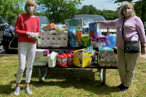 Laurie Griffith, branch manager, assistant vice-president of Darien Bank & Trust, right, donated $500 worth of household items to Diane Barston, program assistant, Darien Human Services, for its Household Supply Closet
