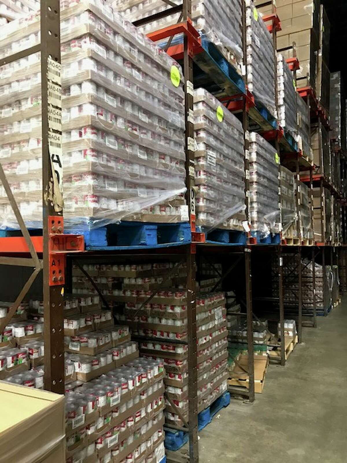 Thousands of cans of soup newly arrived await distribution to 600 soup kitchens, food pantries and homeless shelters among 1,000 agencies the Regional Food Bank services.