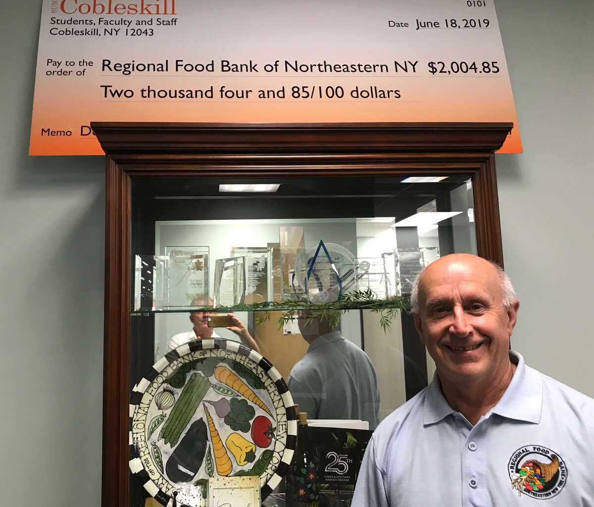 A display case at the Regional Food Bank of Northeastern New York contains numerous awards that Quandt and the organization have received since he began running it in 1983, the year after it was established.