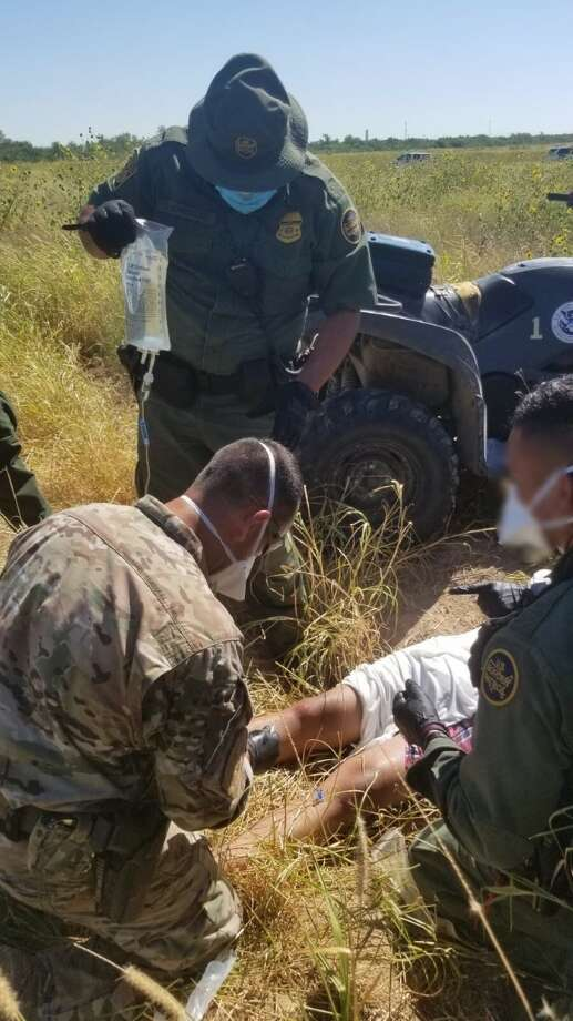U.S. Border Patrol agents rendered life-saving aid to two juveniles who had crossed the border illegally Photo: Courtesy