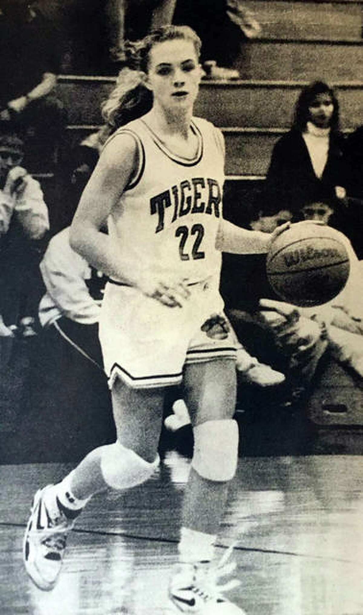 Edwardsville graduate Heather Haskins brings the ball down her senior season at EHS in 1991-92.