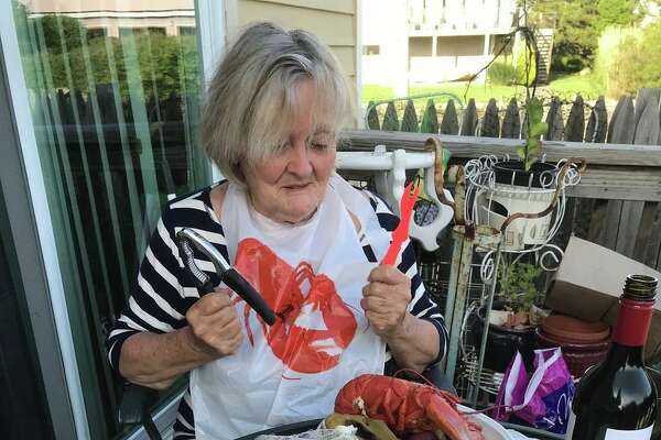 """The New England Chowdafest will hold another """"Clambake to Go"""" July 26. Each clambake (which comes in a pot you get to keep) includes a 1.5 lb. lobster, clams, mussels, sausage, potatoes and corn on the cob."""