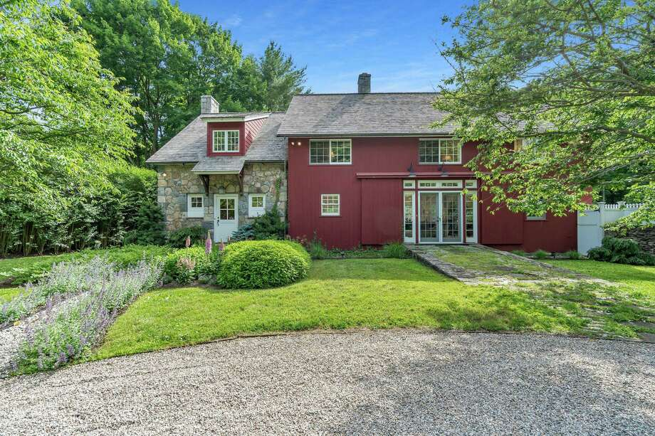 The antique red clapboard and stone barn-turned-house at 232 Compo Road South dates back to the 19th century.