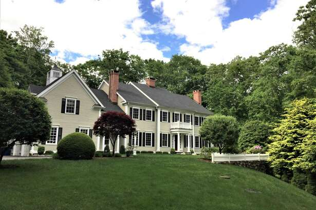 """The colonial house at 5 Overbrook Lane in Lower Weston is classic and """"casual yet elegant,"""" with 15 rooms and 6,412 square feet of living and entertaining space."""