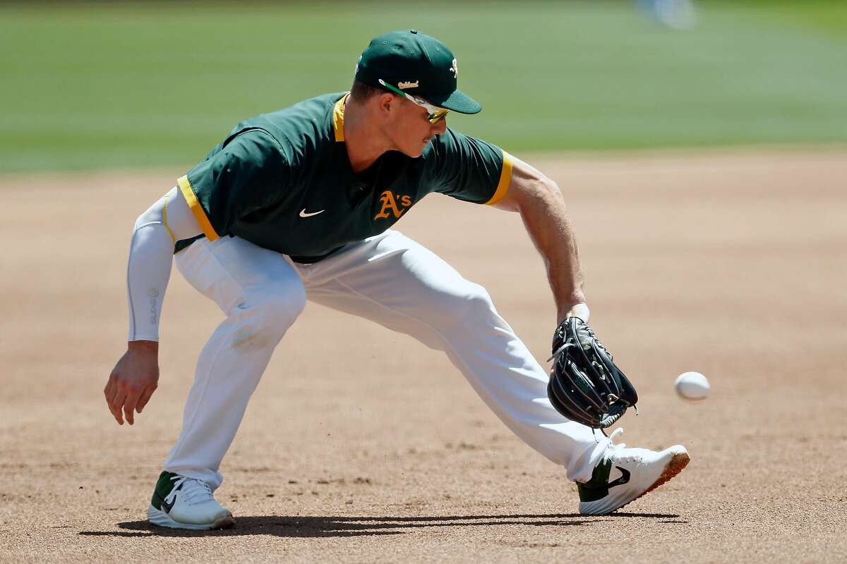 Oakland Athletics' Matt Chapman fields a grounder during practice at Oakland Coliseum in Oakland, Calif., on Wednesday, July 8, 2020.