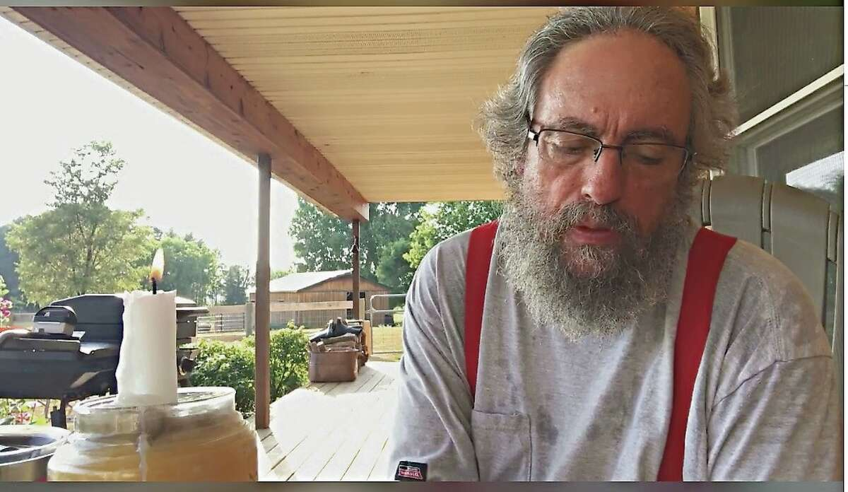 Pastor Phil does his daily devotion July 10 live on Facebook from his cousin's front porch. (Courtesy Photo)