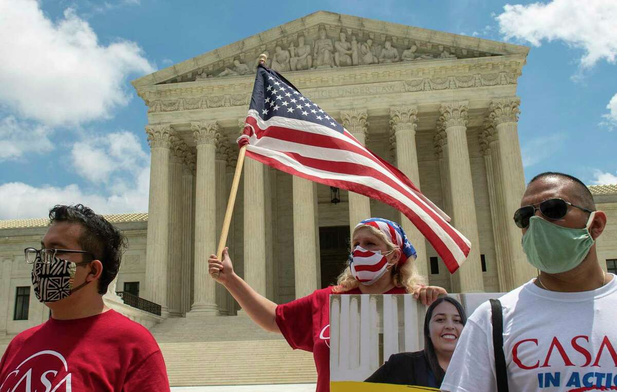 Advocates gather Thursday as the Supreme Court rejected an attempt to dismantle DACA.
