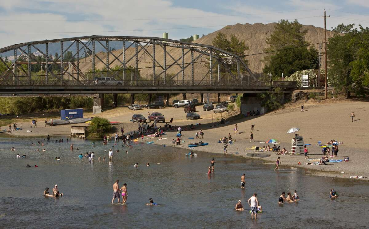 People flock to Memorial Beach to cool off during the 105 degree heat wave on June 16, 2012, in Healdsburg, Calif.