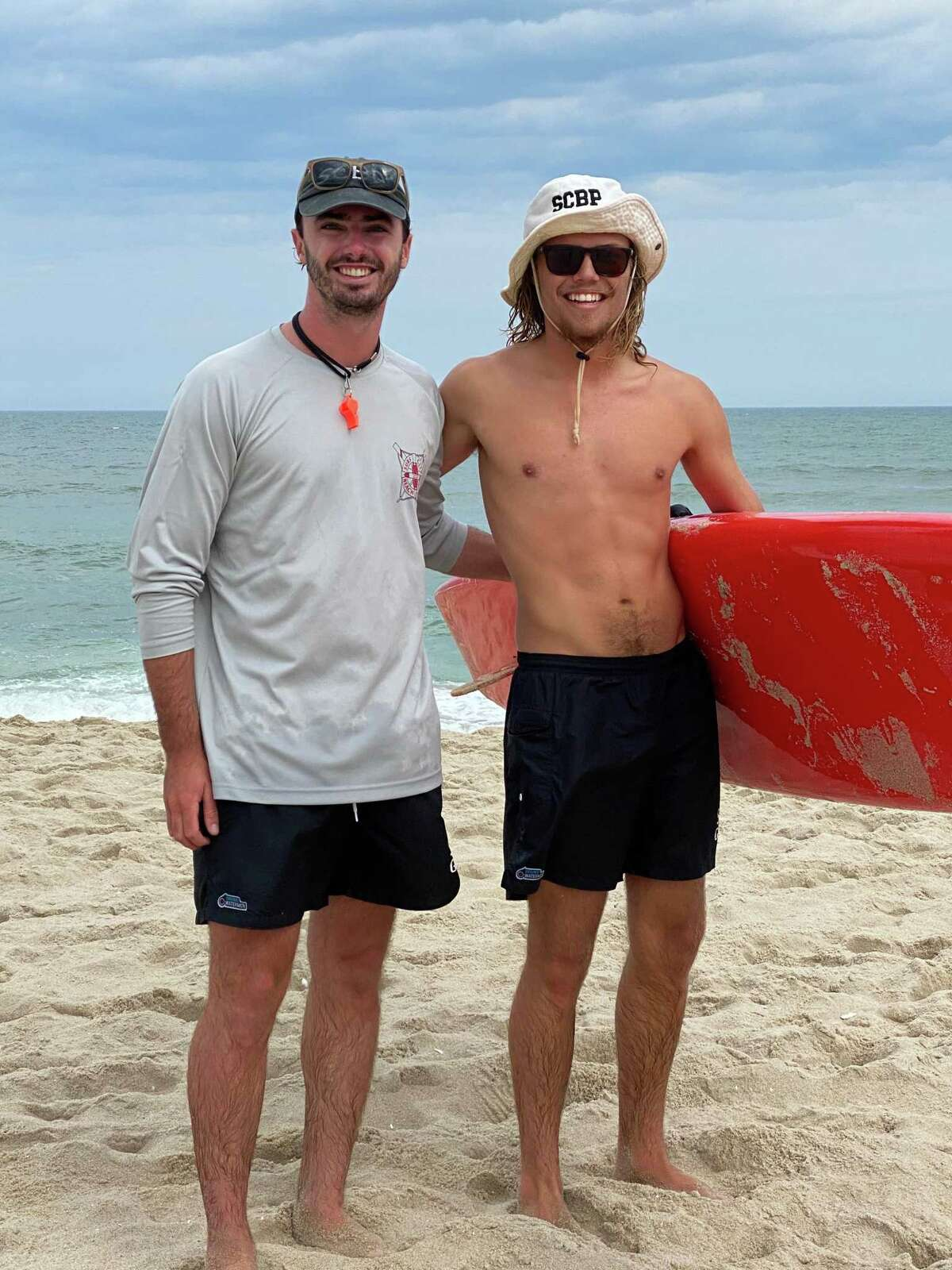 Lifeguards Charlie Osborne of New Milford, left, and Scott Meggitt recently rescued a pilot from the water after his banner plane crashed into the waters off the shores of Surf City, N.J.