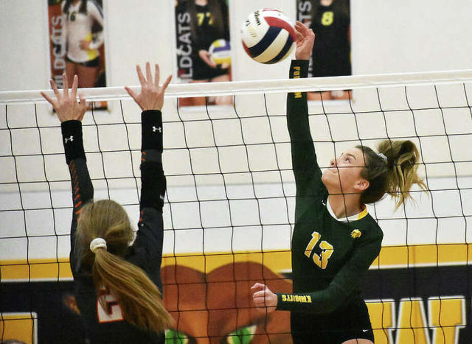 Metro-East Lutheran's Phoebe Russell connects for a kill in the first game against Lincolnwood in a Class 1A regional semifinal in Mount Olive. Photo: Matt Kamp|The Intelligencer