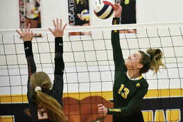 Metro-East Lutheran's Phoebe Russell connects for a kill in the first game against Lincolnwood in a Class 1A regional semifinal in Mount Olive.