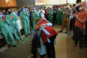 A patient is released in mid-May 2020 from Danbury Hospital in Danbury, Conn., after recovering from complications of COVID-19. Danbury-based Iqvia will help AstraZeneca accelerate trials of a vaccine candidate to which the U.S. government has extended a $1.2 billion commitment to produce if proven effective.