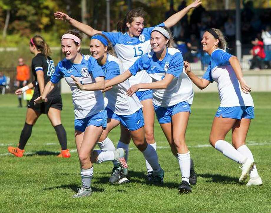 After scoring the 2018 Region 24 championship game's only goal, Lewis and Clark's Claire Dalton, far left, is mobbed by teammates (from left) Audrey Andrzejewski, Allie Smith (15), Megan Pierce and Kassidy Louvall after a 1-0 win over rival Southwestern Illinois College. Because of the coronavirus pandemic, women's and men's soccer, as well as women's volleyball would switch from fall to spring the school year under a plan put forth by the NJCAA. Photo: Jan Dona | For The Telegraph