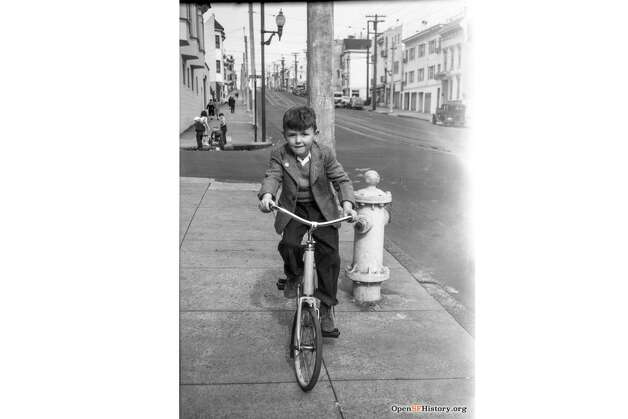 A young boy goes for a bike ride in the 1940s on Church toward Clipper in San Francisco. Photo: OpenSFHistory / Wnp14.12978.jpg