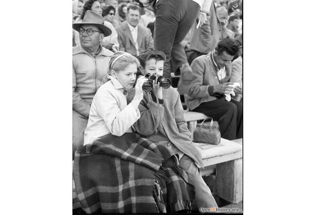 Judy Babcock, 11, and Don Koenig, 13, watch the action on the field during a football game at Kezar Stadium in 1960. Photo: OpenSFHistory / Wnp14.6963.jpg