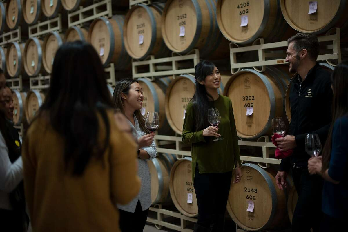 Todd Maltbie, right, hosting a group of visitors from Hawaii during a barrel tasting at ZD Wines in Napa, California. February, 2019.