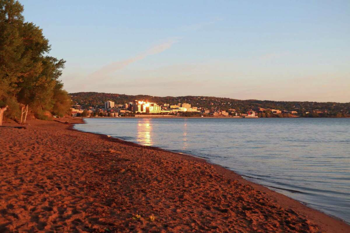The morning sun paints a beach along Park Park, a sandy spit in Duluth, Minn., at the western end of Lake Superior.