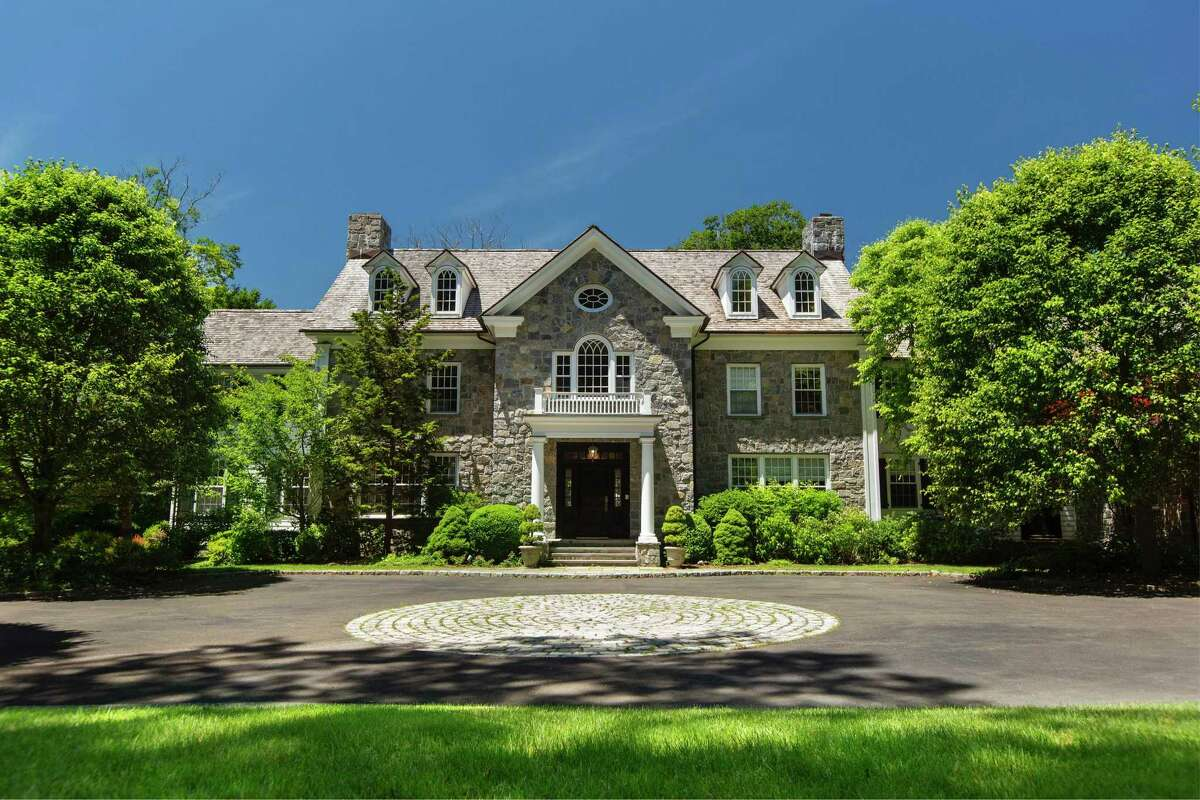 Listed for $3.995 million by Douglas Elliman Real Estate, 69 Porchuck Road is a six-bedroom, more than 9,100-square-foot Georgian colonial on 4.18 acres. Privately sited, with a pool, grand entertaining rooms and two offices on the main level, the property has gotten particular interest in buyers coming from Manhattan, according to the listing broker. Jennifer Leahy, a Realtor with Douglas Elliman Real Estate, said her brokerage saw a