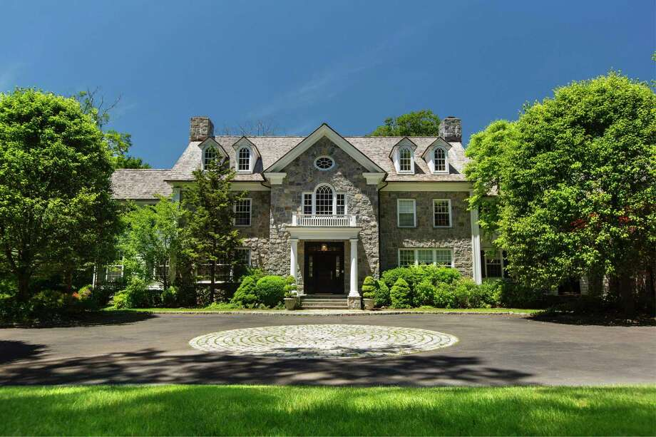 Listed for $3.995 million by Douglas Elliman Real Estate, 69 Porchuck Road is a six-bedroom, more than 9,100-square-foot Georgian colonial on 4.18 acres. Privately sited, with a pool, grand entertaining rooms and two offices on the main level, the property has gotten particular interest in buyers coming from Manhattan, according to the listing broker. Photo: Douglas Elliman Real Estate / Contributed Photo