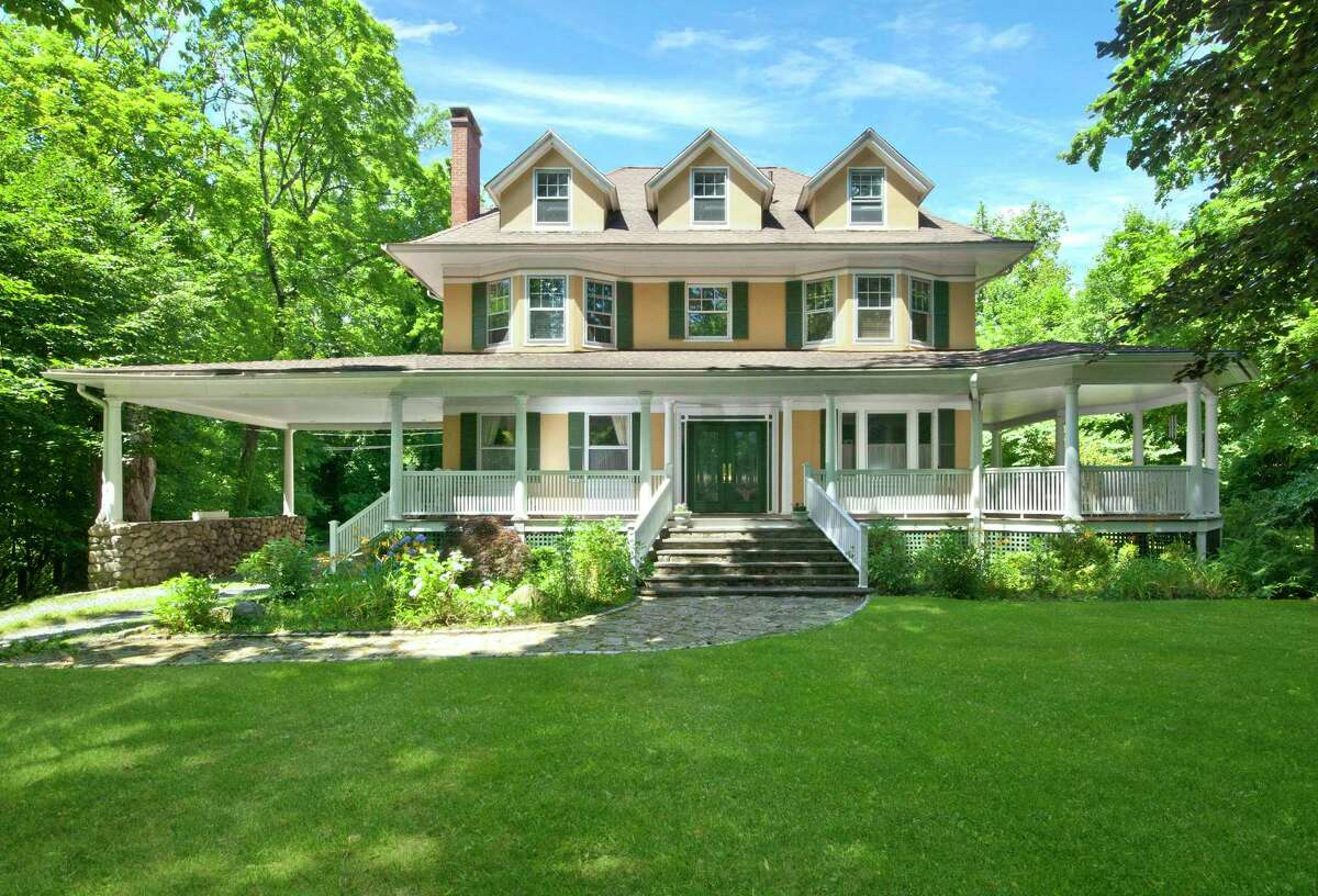 With five bedrooms, 1.68 acres of land, an iconic wraparound porch, deck, and a deep yard, the 1913-era Victorian at 505 E. Putnam Ave. is currently listed for $2.55 million by Berkshire Hathaway HomeServices. The property is conveniently located close to Greenwich High School.