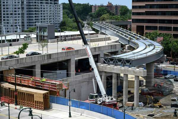 In this June 11 photo, Purple Line construction continues on the overpass at the Paul S. Sarbanes Transit Center in downtown Silver Spring. It took five years to complete the environmental impact analysis on the project.