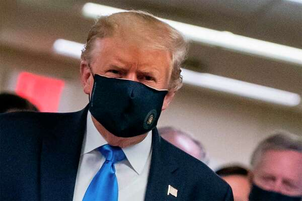 President Donald Trump wears a mask for the first time publicly as he visits Walter Reed National Military Medical Center in Bethesda, Maryland on Saturday.