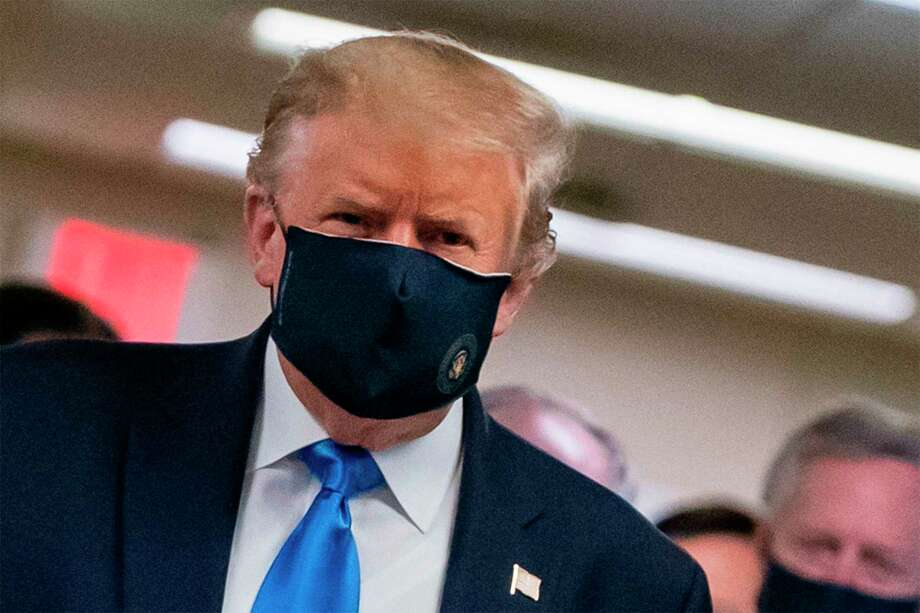 President Donald Trump wears a mask for the first time publicly as he visits Walter Reed National Military Medical Center in Bethesda, Maryland on Saturday. Photo: Alex Edelman / AFP Via Getty Images / AFP or licensors