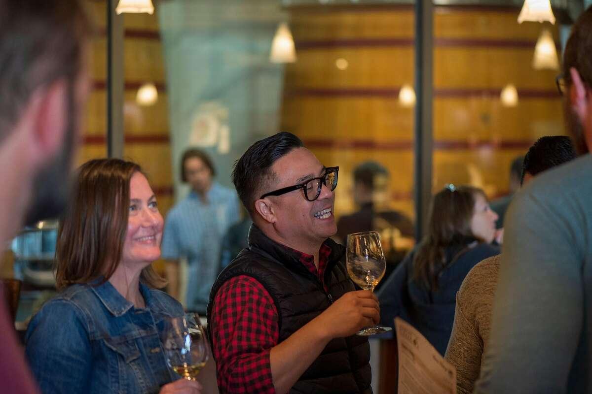 Customers taste at Tablas Creek Vineyard tasting room in Paso Robles, Calif.