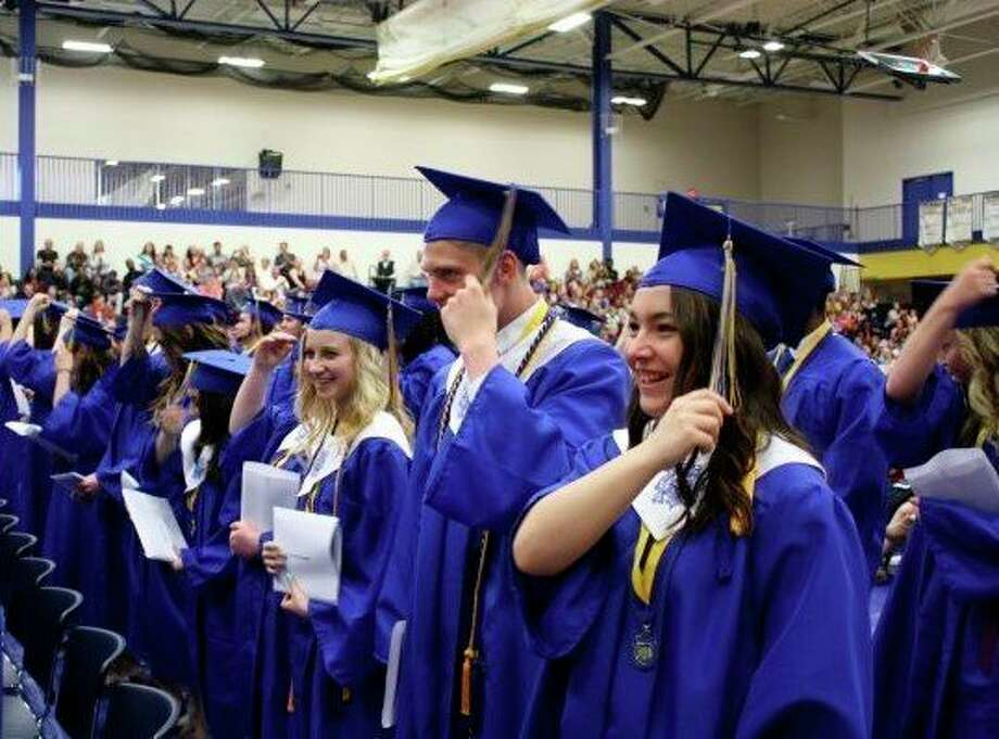 Morley Stanwood High School seniors flip their tassels during this 2017 commencement ceremony. This year, the ceremony will take place outdoors with social distancing enforced. (Pioneer file photo)