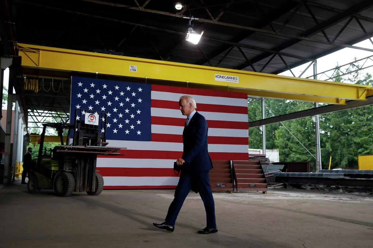 Democratic presidential candidate former Vice President Joe Biden walks from the podium after speaking at McGregor Industries in Dunmore, Pa. Biden is pledging to define his presidency by a sweeping economic agenda beyond anything Americans have seen since the Great Depression and the industrial mobilization for World War II.