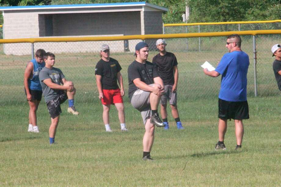 Morley Stanwood Art Campione (right) works with his players on Monday during conditioning sessions at the Mohawk practice field. (PIoneer photo/John Raffel)
