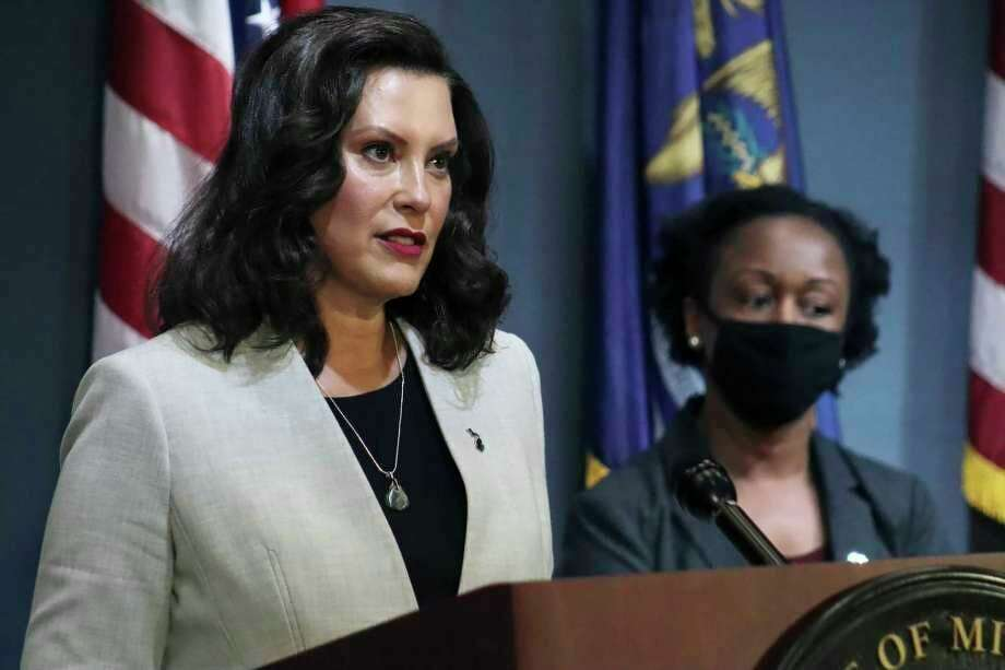 Gov. Gretchen Whitmer on Tuesday extended Michigan's coronavirus emergency declaration through Aug. 11, citing an uptick in new cases over the past three weeks. (Michigan Office of the Governor via AP, Pool, File)
