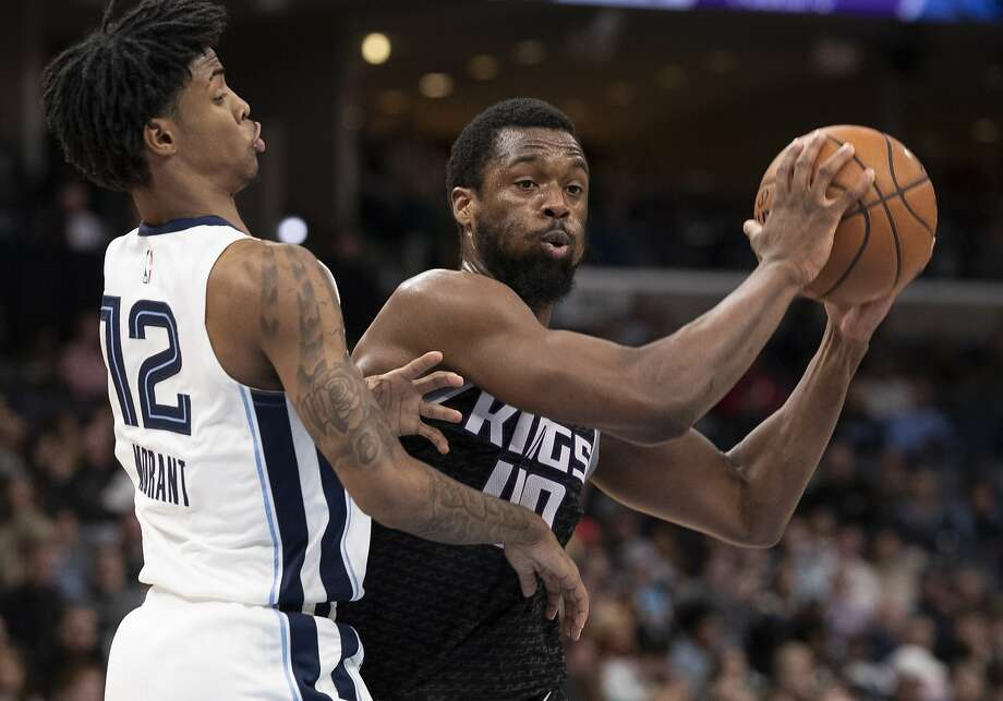 FILE - In this Feb. 28, 2020, file photo, Sacramento Kings forward Harrison Barnes (40) looks to pass while defended by Memphis Grizzlies guard Ja Morant (12) during the first half of an NBA basketball game in Memphis, Tenn. Harrison Barnes became the latest NBA player to reveal that he has coronavirus, making the announcement Tuesday, July 14, 2020, and saying he has hopes to join his team at the league's restart later this summer. (AP Photo/Nikki Boertman, File) Photo: Nikki Boertman / Associated Press