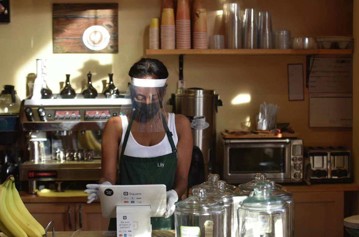 Lily Damtew, owner of Abyssinia Market and Coffee House reopens her small business in Alexandria, Va., on Saturday, July 11, 2020.