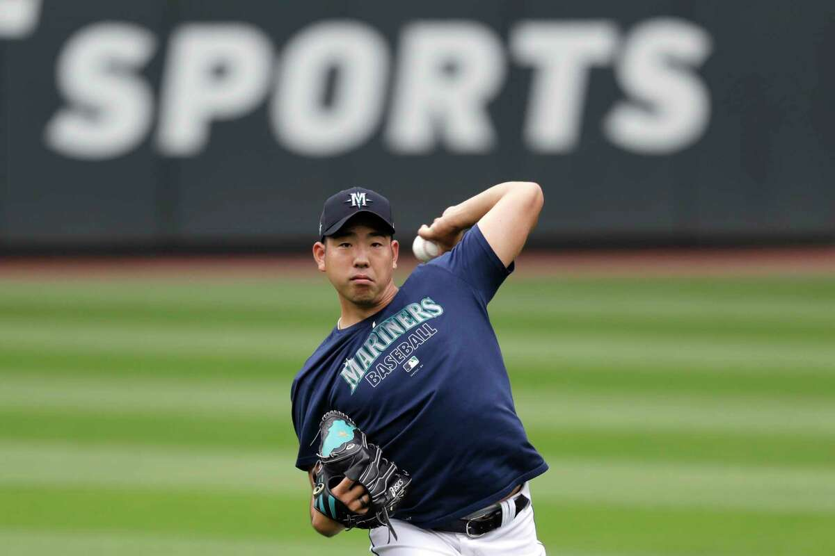 FILE - In this July 3, 2020, file photo, Seattle Mariners pitcher Yusei Kikuchi throws the ball at a baseball practice in Seattle. Even in a 60-game sprint season, this will not be the year that team comes to fruition. If anything, the truncated season may delay some of the Mariner's rebuilding plans, but still with the optimistic hope the club begins turning the corner into contention in 2021.