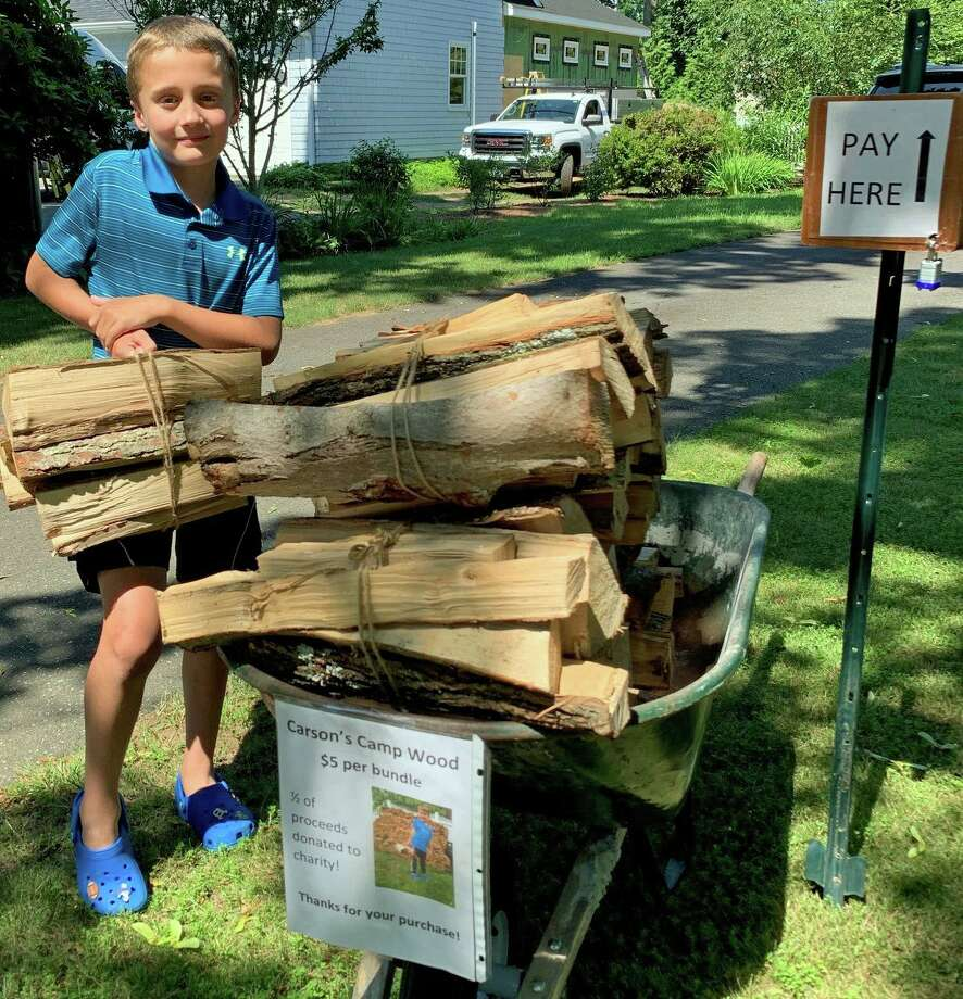 Eight-year-old entrepreneur Carson Garaventa started Carson's Camp Wood for profit and for charity, donated half of his proceeds to the Shoreline Soup Kitchens & Pantries. Photo: Sarah Kyrcz / Hearst Connecticut Media