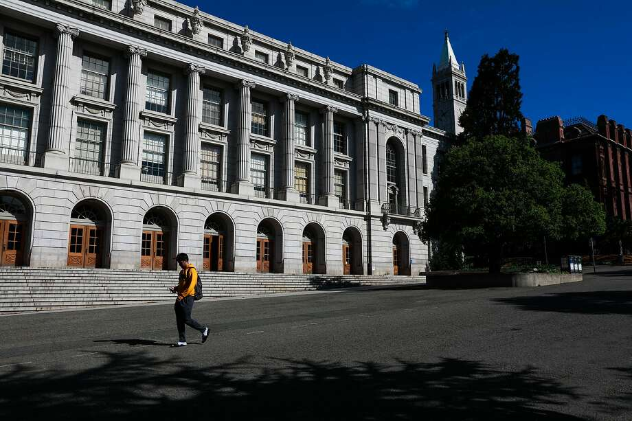 A person walks through the UC Berkeley campus passing Wheeler Hall a day after Berkeley suspended in-person classes through the end of Spring break due to the coronavirus on Tuesday, March 10, 2020 in Berkeley, California. Photo: Gabrielle Lurie / The Chronicle