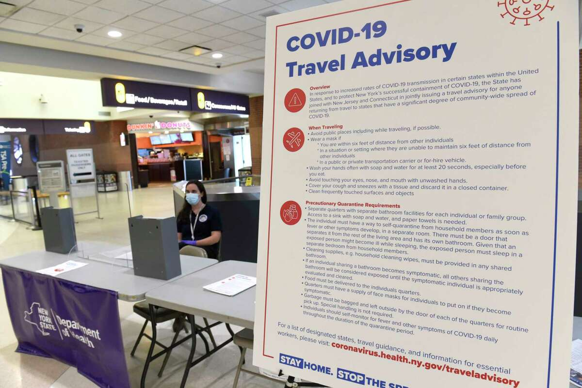 Health Department officials have people fill out forms if they're arriving from Covid hotspot states at the Albany International Airport Tuesday, July 14, 2020 in Colonie, N.Y. (Lori Van Buren/Times Union)