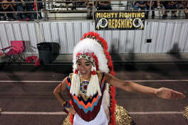 Donna high school cheerleader Cristine Valdez, 17, performs during the game with Sharyland Friday Oct. 18, 2013 at Bennie La Parade Stadium in Donna, Tx. Sharyland won 47-20.