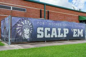 """A banner along the Port Neches-Groves field house inside the football stadium with the Indians mascot logo and the battle cry to """"Scalp 'Em."""" Photo made on July 9, 2020. Fran Ruchalski/The Enterprise"""