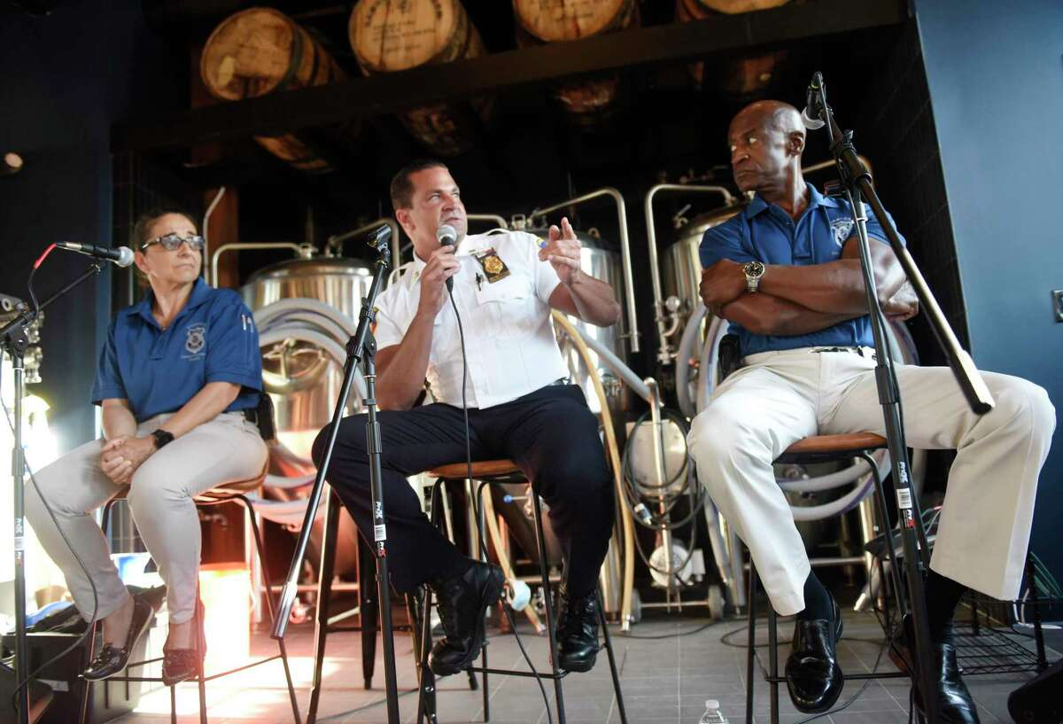 """Stamford Police Captain Diedrich Hohn, center, speaks beside officers Adriana Molina, left, and Silas Redd during the """"Cops and Hops"""" panel discussion at Third Place by Half Full Brewery in Stamford on Monday. The police engaged in a thoughtful discussion on current events in Stamford."""