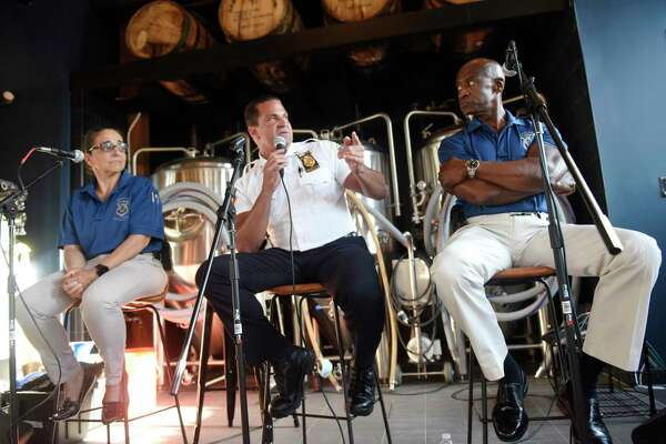 "Stamford Police Captain Diedrich Hohn, center, speaks beside officers Adriana Molina, left, and Silas Redd during the ""Cops and Hops"" panel discussion at Third Place by Half Full Brewery in Stamford, Conn. Monday, July 13, 2020. The police engaged in a thoughtful discussion on current events in Stamford."
