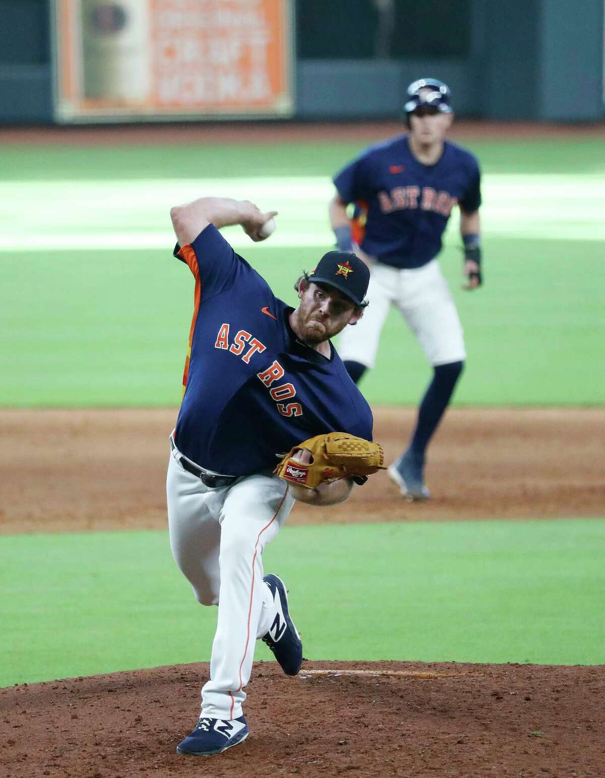Houston Astros pitcher Joe Biagini pitches during an intrasquad game at the Astros summer camp at Minute Maid Park, Tuesday, July 14, 2020, in Houston.