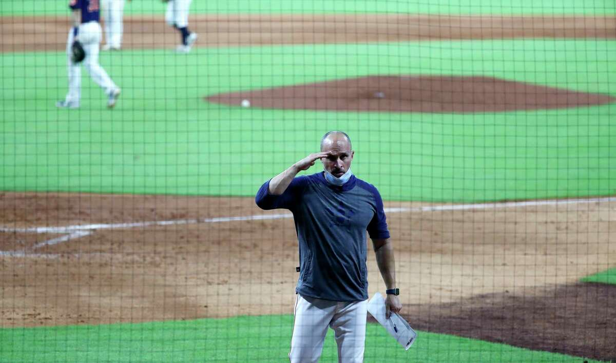 Houston Astros bench coach Joe Espada signals the game is over during an intrasquad game at the Astros summer camp at Minute Maid Park, Tuesday, July 14, 2020, in Houston.