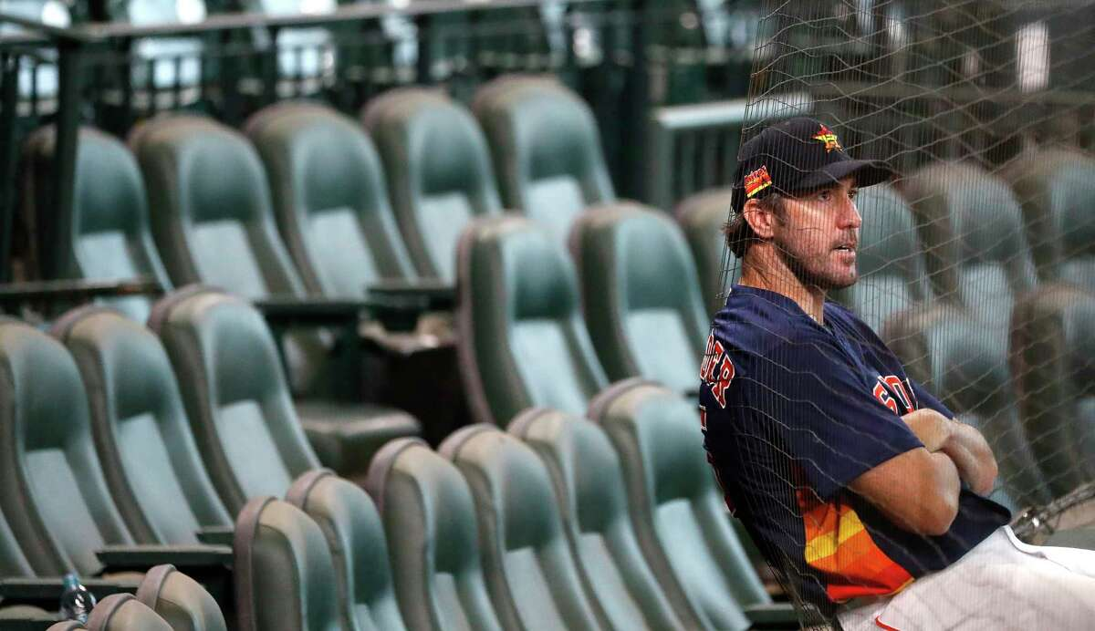 Houston Astros pitcher Justin Verlander leans against the netting of the Diamond Club after pitching during an intrasquad game at the Astros summer camp at Minute Maid Park, Tuesday, July 14, 2020, in Houston.