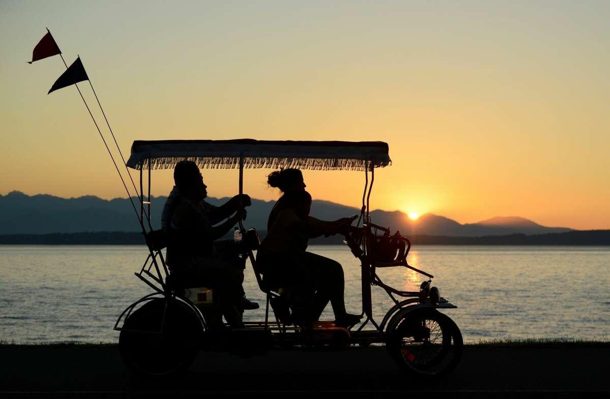 Summer sunset on Alki Beach in Seattle.