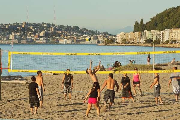 Summer Beach Volleyball, popular summer activity on the city's best beach, Alki Beach, Seattle, Washington, USA, September, 2012