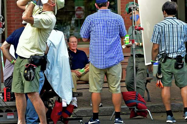 New England Patriots coach Bill Belicheck on Main Street in Branford Tuesday filming a commercial for Subway.
