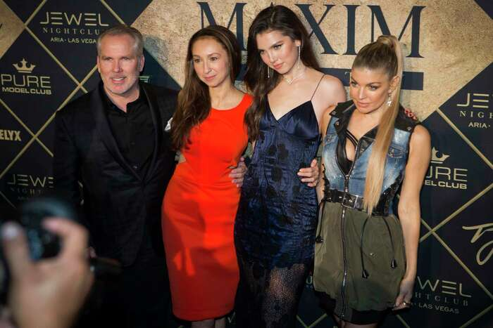Thomas J. Henry, his longtime partner Azteca Henry, their daughter Maya Henry and entertainer Fergie pose for photographs at the Maxim Super Bowl Party 2017, presented by Thomas J. Henry at the Smart Financial Centre at Sugar Land on Feb. 5, 2017.